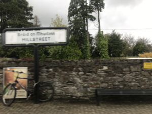 Rock walls blur as the train picks up speed leaving the station in Ireland